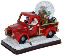 Kerstman-met-sneeuwbol-in-pickup-truck